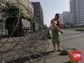 FOTO: Cara 'Nyeleneh' Menikmati Sepinya Jakarta