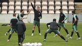 Suasana latihan timnas Portugal kian bersemangat dengan kehadiran Cristiano Ronaldo yang terkenal ambisius meraih gelar prestisius. (AP Photo/Luis Vieira)