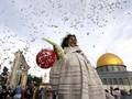 FOTO: Dunia Kembali Suci Lewat Idul Fitri