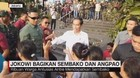 VIDEO: Jokowi Bagikan Sembako & Angpao ke Warga Tambora