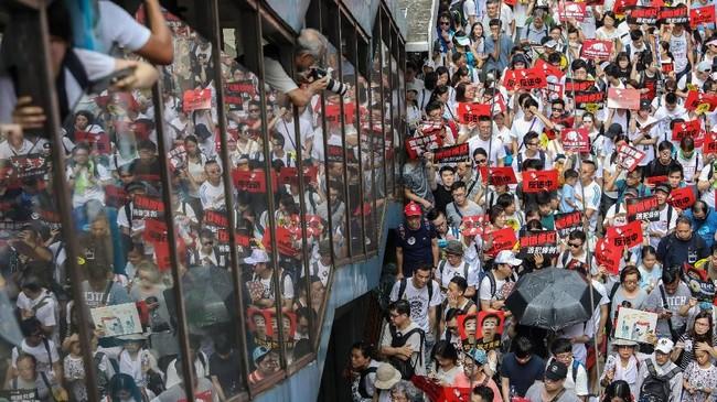 Selama ini sistem hukum independen kota dijamin berdasarkan undang-undang yang mengatur kembalinya Hong Kong dari Inggris ke China pada 22 tahun lalu. (Photo by DALE DE LA REY / AFP)