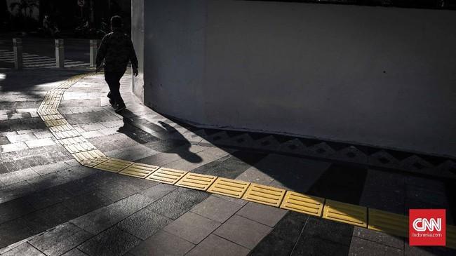 PNS sendiri memiliki batas waktu hingga pukul 15.00 WIB untuk melaporkan absensi di hari pertama kerja. (CNNIndonesia/Safir Makki)