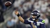 6.Pemain American Football Russell Wilson yang membelaSeattle Seahawks duduk di peringkat keenam dengan total pendapatan US$89,5 juta [Rp1,274 triliun]. (Ronald Martinez/Getty Images/AFP)