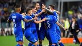 Kemenangan Italia membuat mereka mengoleksi 12 poin dari empat laga yang telah mereka jalani. (REUTERS/Massimo Pinca)