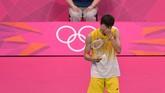 Meski meraih banyak gelar super series, Lee Chong Wei sering menuai nasib sial di dua turnamen penting, Olimpiade dan Kejuaraan Dunia. Foto ini saat Chong Wei gagal di final Olimpiade.(ADEK BERRY/AFP)