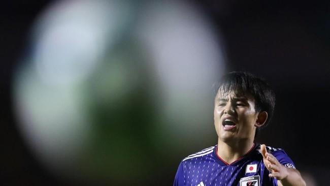 Pemain anyar Real Madrid, Takefusa Kubo, menjadi salah satu andalan Jepang dalam membongkar pertahanan Chile. (REUTERS/Ueslei Marcelino)