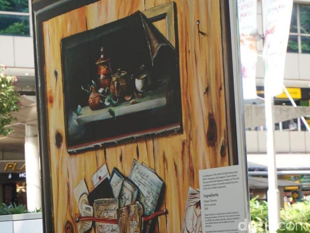 Deepi Sharma memberikan judul lukisan ini dengan Ingridients. Terlihat beberapa mahan makanan, buku resep hingga seorang chef. Foto: dok. detikFood/ Lusiana Mustinda