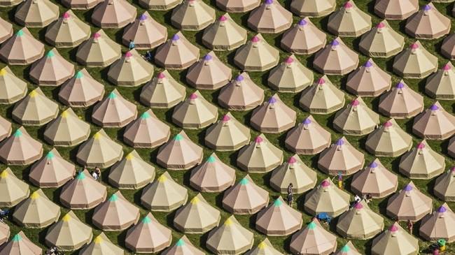 Tahun ini, Glastonbury Festival dilaksanakan pada 26 hingga 30 Juni dengan konsep yang masih berpegang pada identitas aslinya: konser ruang terbuka. (Aaron Chown/PA Wire( / PA via AP)