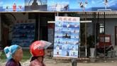 Satu paket pemotretan yang berisi 35 foto dibanderol seharga 199 yuan (Rp410 ribu), kata Zhang Hongtao, pengelola studio foto. (REUTERS/Tingshu Wang)