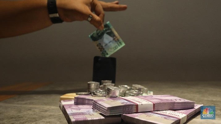 Pembukaan Pasar: Rupiah Melemah ke Rp 14.065/US$