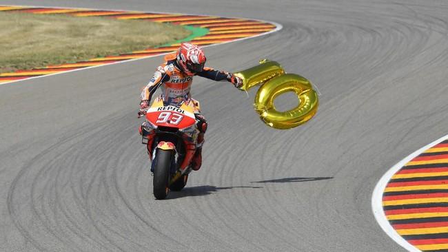 Marc Marquez sudah meraih 10 kemenangan di seluruh kelas di Jerman, dengan rincian satu kemenangan di 125cc, dua kemenangan di Moto2, dan tujuh di MotoGP.(Photo by Tobias SCHWARZ / AFP)