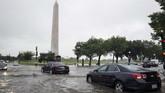 Banjir bandang menerjang sebagian wilayah Washington pada Senin (8/7) waktu setempat. (AP Photo/Alex Brandon)