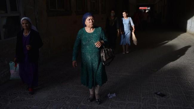 Sebanyak 22 negara melayangkan surat terbuka ke pejabat urusan hak asasi manusia di Perserikatan Bangsa-Bangsa (PBB) berisi kecaman atas perlakuan China terhadap Uighur dan kelompok minoritas lainnya di Xinjiang. (Photo by Greg Baker / AFP)