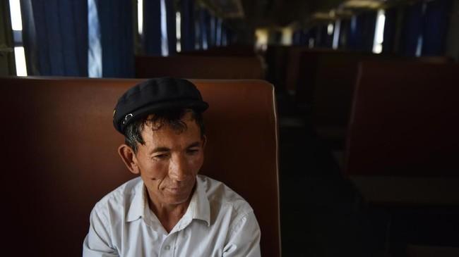 Berdasarkan kesaksian korban, otoritas China terus melakukan penahanan massal sewenang-wenang terhadap Uighur dan minoritas Muslim lain di Xinjiang sejak 2014 lalu. (Photo by Greg Baker / AFP)
