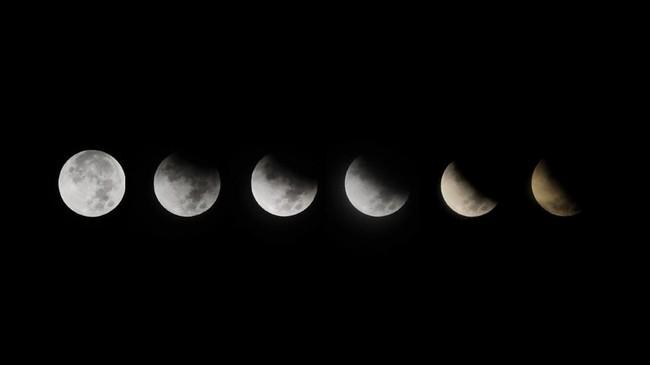 Fenomena gerhana bulan sebagian menerangi seluruh kawasan Indonesia pada Rabu (17/7) dini hari, salah satunya seperti yang terlihat di Padang, Sumatera Barat.(ANTARA FOTO/Iggoy el Fitra/wsj.)