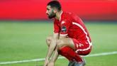 Pemain Tunisia Yassine Meriah meratapi kegagalan timnya di perebutan tempat ketiga Piala Afrika. (REUTERS/Mohamed Abd El Ghany)