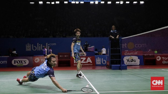 Langkah Ahsan/Hendra diikuti Kevin Sanjaya/Marcus Gideonyang sukses menyingkirkan ganda China Ou Xuan Yi/Zhang Nandua gim langsung, 21-12 dan 21-16. (CNN Indonesia/Adhi Wicaksono)
