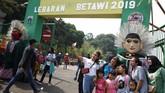 Masyarakat antusias sambut Lebaran Betawi 2019 yang berlangsung di lapangan silang Monas Jakarta, 20 Juli 2019. Pemprov DKI Jakarta menggelar Lebaran Betawi 2019 yang ke-12 bertemakan