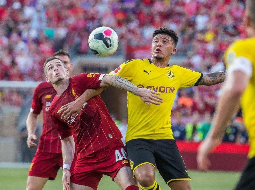 Pertandingan tuntas dengan skor 3-2 untuk kemenangan Dortmund. Die Borussen menambah dua gol lewat Thomas Delaney dan Jacob Bruun Larsen. Liverpool menambah satu lewat penalti Rhian Brewster. (Foto: Trevor Ruszkowski/Reuters)