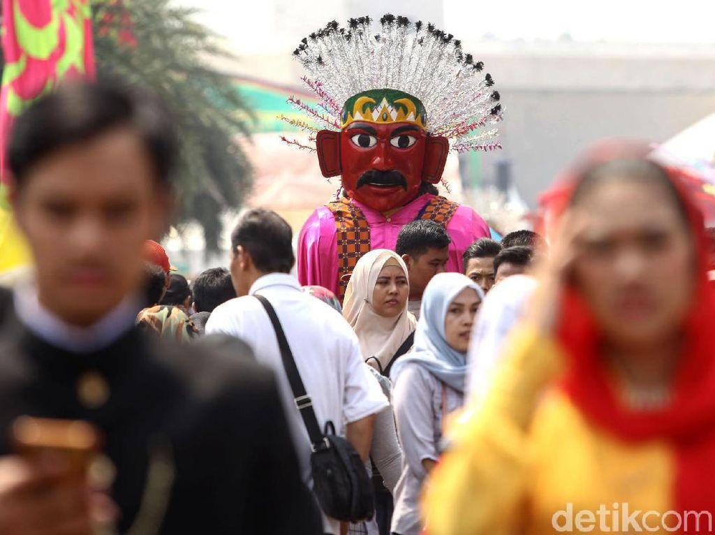 Begini suasana Lebaran Betawi 2019 yang digelar di Monas, Jakarta, Minggu (21/7/2019).