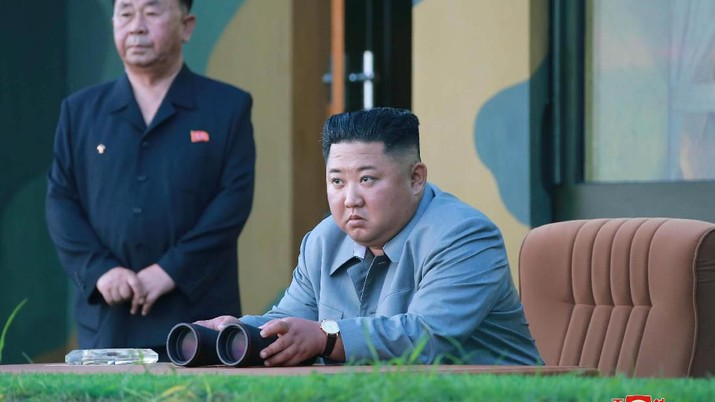 North Korean leader Kim Jong Un watches the test-fire of two short-range ballistic missiles on Thursday, in this undated picture released by North Korea's Central News Agency (KCNA) on July 26, 2019.  KCNA/via REUTERS