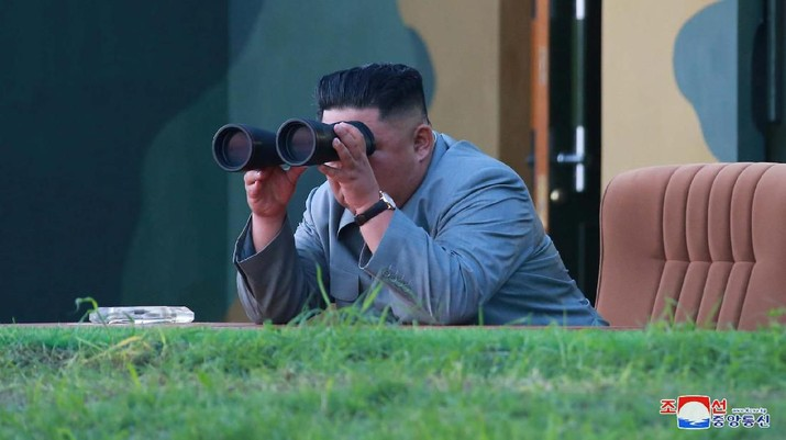 North Korean leader Kim Jong Un watches the test-fire of two short-range ballistic missiles on Thursday, in this undated picture released by North Korea's Central News Agency (KCNA) on July 26, 2019.  KCNA/via REUTERS ATTENTION EDITORS - THIS IMAGE WAS PROVIDED BY A THIRD PARTY. REUTERS IS UNABLE TO INDEPENDENTLY VERIFY THIS IMAGE. NO THIRD PARTY SALES. SOUTH KOREA OUT.