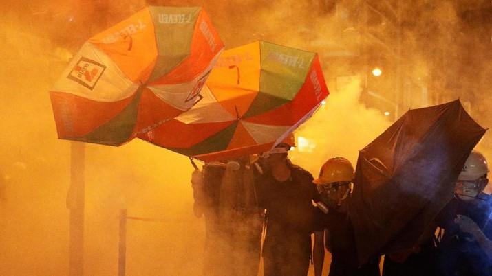 Payung dengan cepat muncul sebagai simbol unjuk rasa di Hong Kong sejak 2014