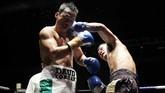 Daud Yordan mendapatkan perlawanan cukup berarti sebelum akhirnya menang lewatTKO jelang ronde keenam atas Aekkawee Kaewmanee. (Dok Mahkota Promotion)