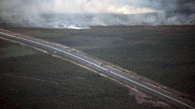 Pantauan dari udara kebakaran lahan gambut di kawasan Pemulutan Kabupaten Ogan Ilir, Sumsel, Senin (5/8/2019). ANTARA FOTO/Mushaful Imam