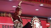 Presiden Joko Widododalam pidatonya membalas ucapan Megawati dengan menjanjikan PDIP jatah kursi menteri terbanyak di kabinet yang barunya.(CNN Indonesia/Safir Makki)