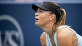 Maria Sharapova sempat bangkit setelah kalah tiga kali beruntun dengan meraih kemenangan atas Alison Riske di babak pertama Cincinnati Masters 2019. (Meg Vogel/The Cincinnati Enquirer via AP)