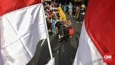 Warga mengikuti karnaval budaya di Cikini, Jakarta, Sabtu(17/8). Lomba tersebut dalam rangka merayakan HUT ke-74 Kemerdekaan RI. (CNN Indonesia/Adhi Wicaksono)