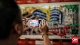 Rangkaian instalasi seni tentang kota Jakarta dan transportasi kereta api tampil menyemarakkan jalur pedestrian terowongan. (CNN Indonesia/Andry Novelino)