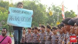 Jokowi Diminta Jamin Aksi Rasial ke Orang Papua Tak Terulang