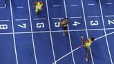 Sejumlah pihak menilai Usain Bolt bisa memiliki catatan waktu yang lebih baik dari 9,58 detik di Kejuaraan Dunia Atletik 2009 jika tidak melambatkan larinya. (HARALD LIBUDA / AFP)