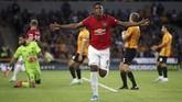 Anthony Martial mencetak gol yang membuat MU unggul pada menit ke-27. (Nick Potts/PA via AP)