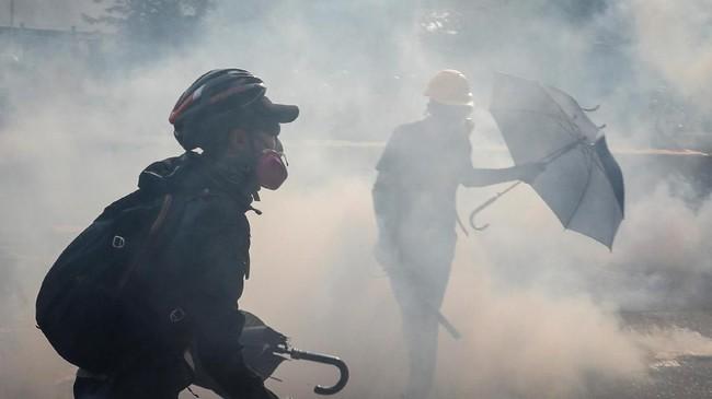 Aksi itu menuntut pemerintah menganulir peraturan yang membolehkan pelanggar hukum di Hong Kong diekstradisi ke China daratan. (REUTERS/Tyrone Siu)