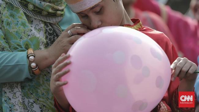 Pawai itu diselenggarakan oleh Koalisi Nasional POKJA Implementasi. (CNN Indonesia/Adhi Wicaksono)