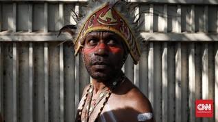 FOTO: Warna-warni Aksi Damai untuk Papua