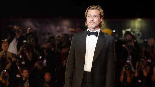 Tak lupa, ajang Venice Film Festival tahun ini juga jadi momen Brad Pitt mempromosikan film terbaru yang ia bintangi, Ad Astra. (Arthur Mola/Invision/AP)