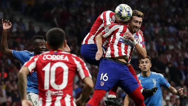 Atletico Madrid akhirnya menyamakan skor menjadi 2-2 lewat sundulan Hector Herrera di pengujung pertandingan. (AP Photo/Manu Fernandez)