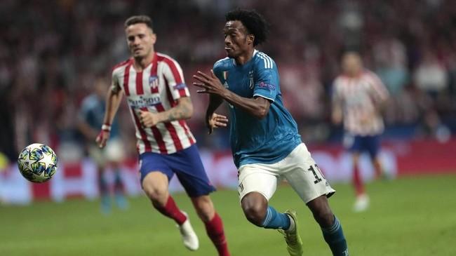 Juan Cuadrado akhirnya memecah kebuntuan di menit ke-48. Tendangan kaki kiri Cuadrado bersarang di pojok kanan gawang Atletico . (AP Photo/Bernat Armangue)