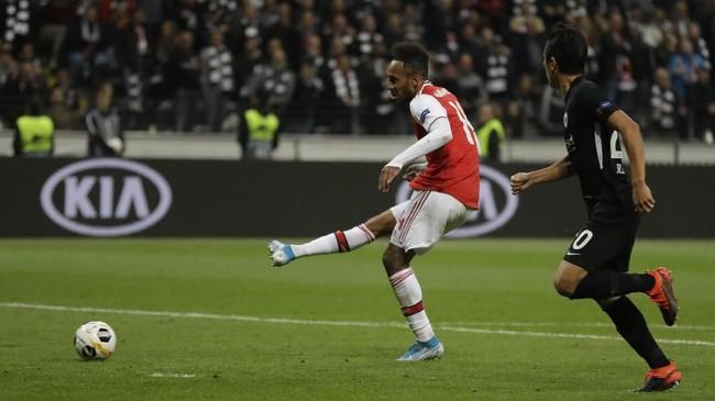 Arsenal menutup kemenangan 3-0 atas Eintracht Frankfurt lewat gol Pierre-Emerick Aubameyang pada menit ke-88. (AP Photo/Michael Probst)