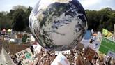 Pemerintah Kota New York mengizinkan sekitar 1,1 juta pelajar untuk bolos sekolah demi mengikuti demonstrasi global terkait perubahan iklim. (AP Photo/Rick Rycroft)