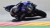 Posisi ketiga ditempati Maverick Vinales setelah pebalap Yamaha itu terpaut 0,463 detik dari Marc Marquez. (JOSE JORDAN / AFP)