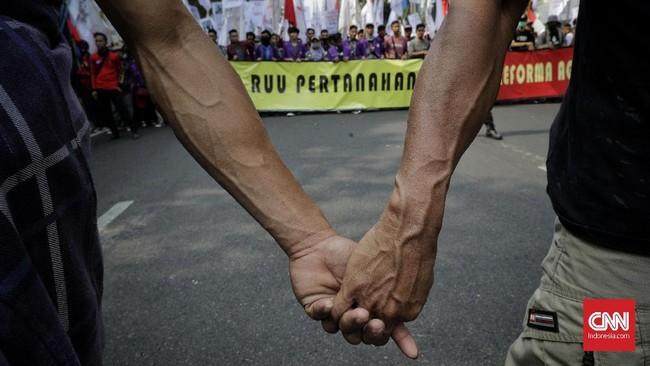 Masa gabungan petani, mahasiswa dan buruh melakukan aksi di depan Istana Negara menolak pengesahan RUU Pertanahan dan RUU Sistem Budidaya Pertanian Berkelanjutan (SBPB). Jakarta, Selasa, 24 September 2019.(CNN Indonesia/Adhi Wicaksono).