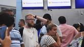 Saat ini, terdapat sekitar 600 ribu turis yang sedang berlibur dan menggunakan jasa Thomas Cook. (Photo by ELIZABETH RUIZ / AFP)