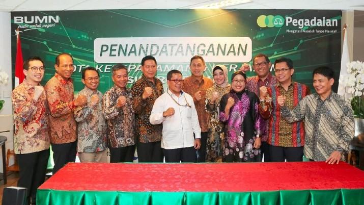 PT Bank Rakyat Indonesia Tbk bersama dengan PT Pegadaian menandatangani Nota Kesepahaman tentang sinergi bisnis.