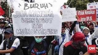 FOTO : Buruh Turun ke Jalan Tolak RUU Ketenagakerjaan