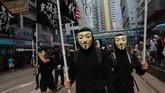 Dalam beberapa waktu ke belakang, aksi unjuk rasamenolak RUU Ekstradisi Hong Kong diwarnai dengan kemunculan beragam masker dan topeng-topeng berkarakter. (AP Photo/Kin Cheung)